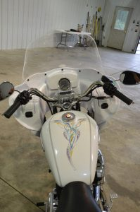 Photo of a white Custom Harley Davidson Sportster with a Wedge Fairing  viewed from the back