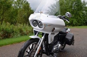 Photo of a white Custom Harley Davidson Sportster with a Wedge Fairing