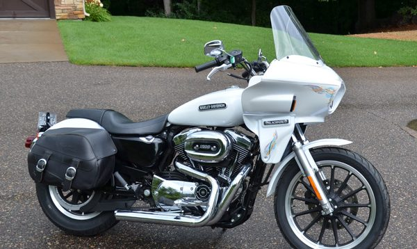 Harley sportster with a touring fairing