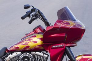 photo of a red harley davidson dyna switchback FLD with a wedge fairing viewed from the side
