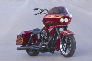 photo of a red custom harley davidson dyna switchback FLD with a wedge fairing