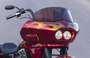 Close up Photo of a  red Custom Harley Davidson Dyna Switchback FLD with a Wedge Fairing
